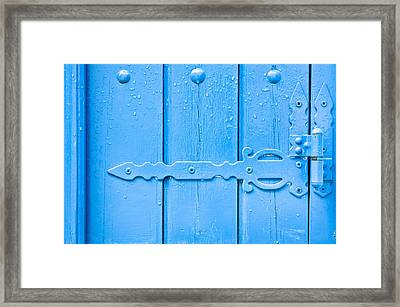 Blue Hinge Framed Print by Tom Gowanlock