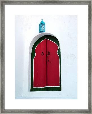 Blue Lantern Over Red Door Framed Print