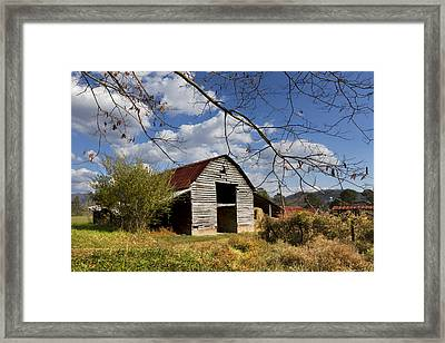 Blue Skies Red Roof Framed Print by Debra and Dave Vanderlaan