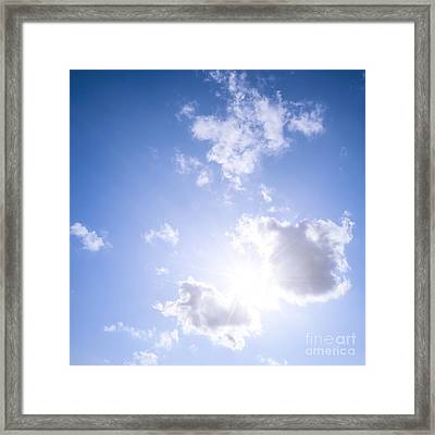 Blue Sky With Sun And Clouds Framed Print