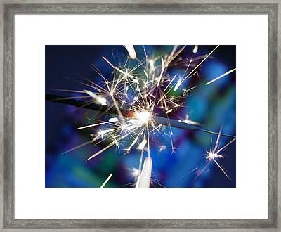 Blue Sparks Framed Print by Rene  Tapia