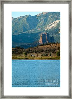 Framed Print featuring the photograph Blue Water And Needlrock by Eric Rundle