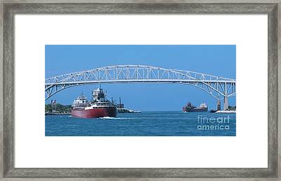 Blue Water Bridge And Freighters Framed Print by Ann Horn