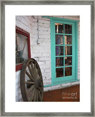 Framed Print featuring the photograph Blue Window And Wagon Wheel by Dora Sofia Caputo Photographic Art and Design