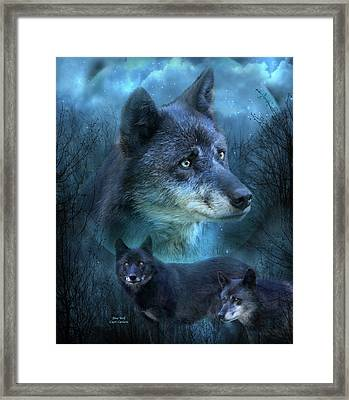 Blue Wolf Framed Print by Carol Cavalaris