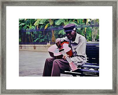 Blues Guitar Player In New Orleans Framed Print by John Malone