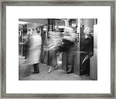 Framed Print featuring the photograph Blurred In Turnstile by Dave Beckerman