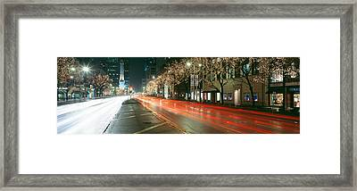 Blurred Motion Of Cars Along Michigan Framed Print by Panoramic Images