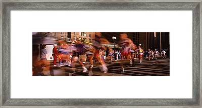 Blurred Motion Of Marathon Runners Framed Print by Panoramic Images