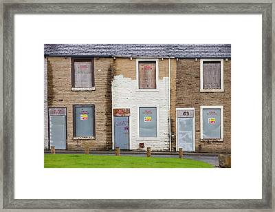 Boarded Up Terraced Houses In Burnley Framed Print by Ashley Cooper