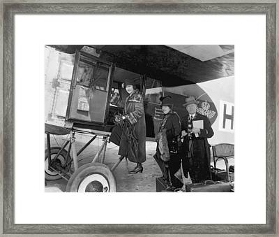 Boarding Fokker Airplane Framed Print by Underwood Archives