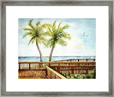 Boardwalk With Two Palms Framed Print