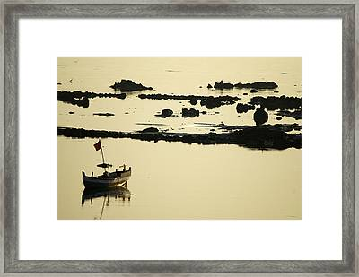 Boat Amongst The Rocks Framed Print