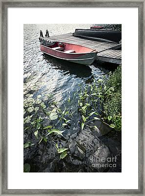 Boat At Dock On Lake Framed Print by Elena Elisseeva