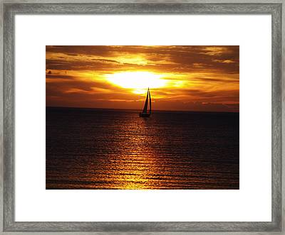Boat At Sunset Framed Print by Susan Crossman Buscho