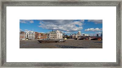 Boat In A River With A Cathedral Framed Print