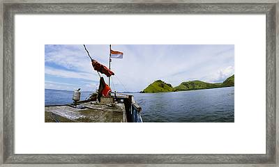Boat In The Sea With Islands Framed Print
