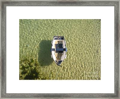Boat On Ocean Framed Print by Pixel Chimp