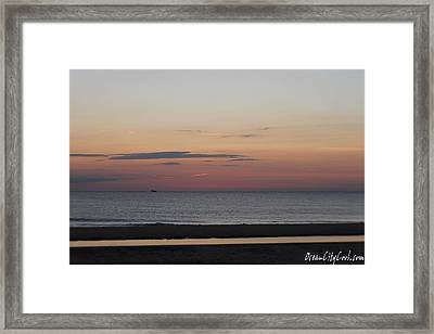 Framed Print featuring the photograph Boat On The Horizon At Sunrise by Robert Banach