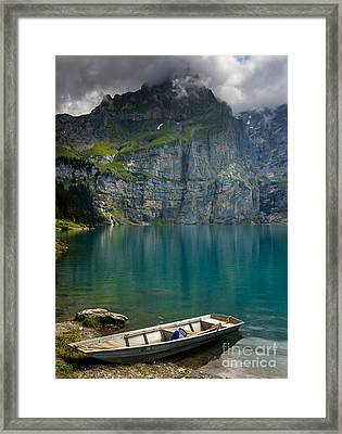 Boat On The Oeschinensee - Swiss Alps  Framed Print by Gary Whitton