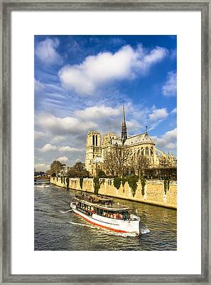 Boat Passing Notre Dame De Paris  Framed Print