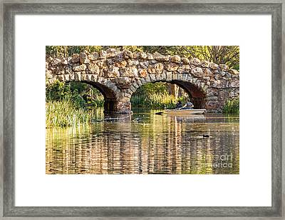 Boaters Under The Bridge Framed Print