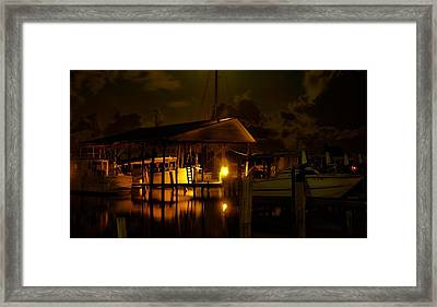 Boathouse Night Glow Framed Print by Michael Thomas