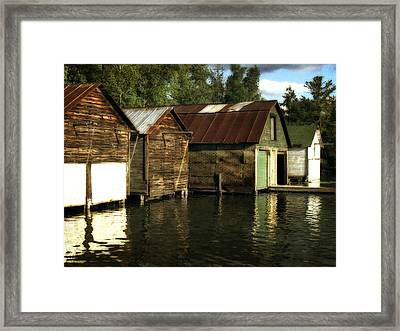 Boathouses On The River Framed Print