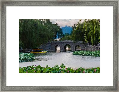 Boating In The Evening Framed Print by Robert Hebert