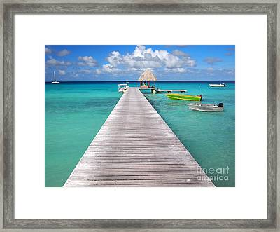 Boats At The Jetty In A Tropical Turquoise Lagoon Framed Print
