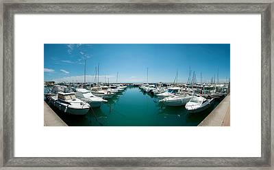 Boats Docked In The Small Harbor Framed Print