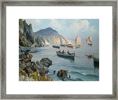 Boats In A Rocky Cove  Framed Print