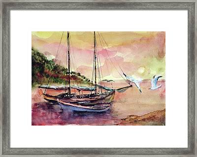 Boats In Sunset  Framed Print by Faruk Koksal