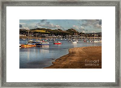 Boats In The Harbour Framed Print by Adrian Evans