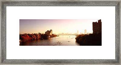 Boats In The River With Cityscape Framed Print