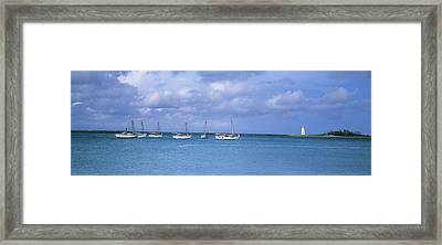 Boats In The Sea With A Lighthouse Framed Print by Panoramic Images