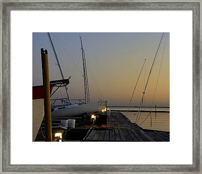 Boats Moored To Pier At Sunset Framed Print by Charles Beeler