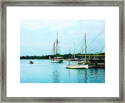 Framed Print featuring the photograph Boats On A Calm Sea by Susan Savad