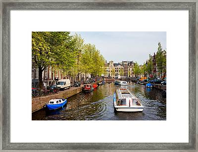 Boats On Canal Tour In Amsterdam Framed Print