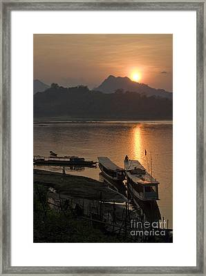 Boats On River By Luang Prabang Laos  Framed Print