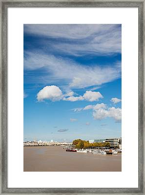 Boats With A City At The Waterfront Framed Print