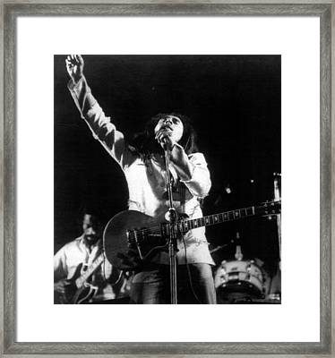 Bob Marley Fist Raised Framed Print by Retro Images Archive