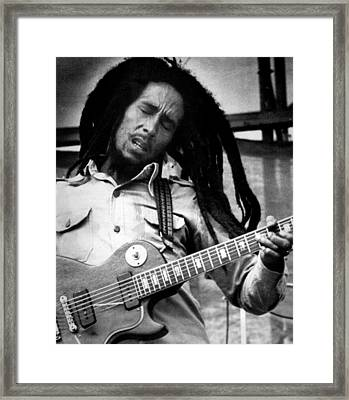 Bob Marley Playing Guitar Framed Print by Retro Images Archive