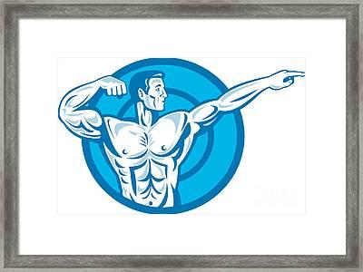 Bodybuilder Flexing Muscles Pointing Side Retro Framed Print by Aloysius Patrimonio