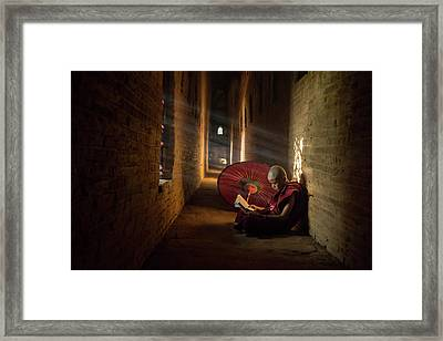 Book And Monk Framed Print