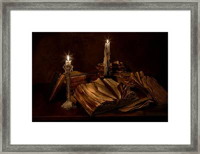 Books And Candles Framed Print