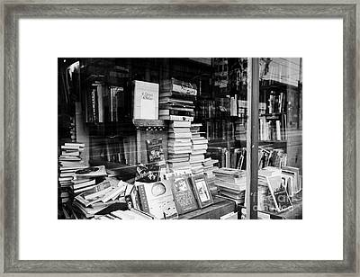 books in the window of a used book store Vancouver BC Canada Framed Print by Joe Fox