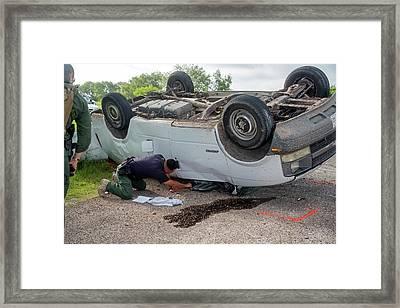 Border Patrol Officer Inspecting A Crash Framed Print by Jim West