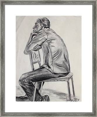 Bored Model Straddling A Chair Framed Print by Asha Carolyn Young