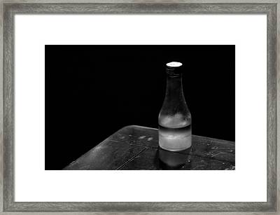 Bottle And Corner Framed Print by Guillermo Hakim